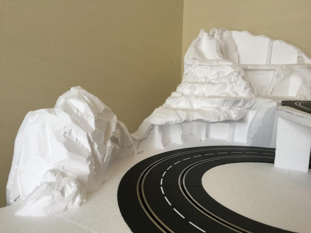 Carving styrofoam rock.